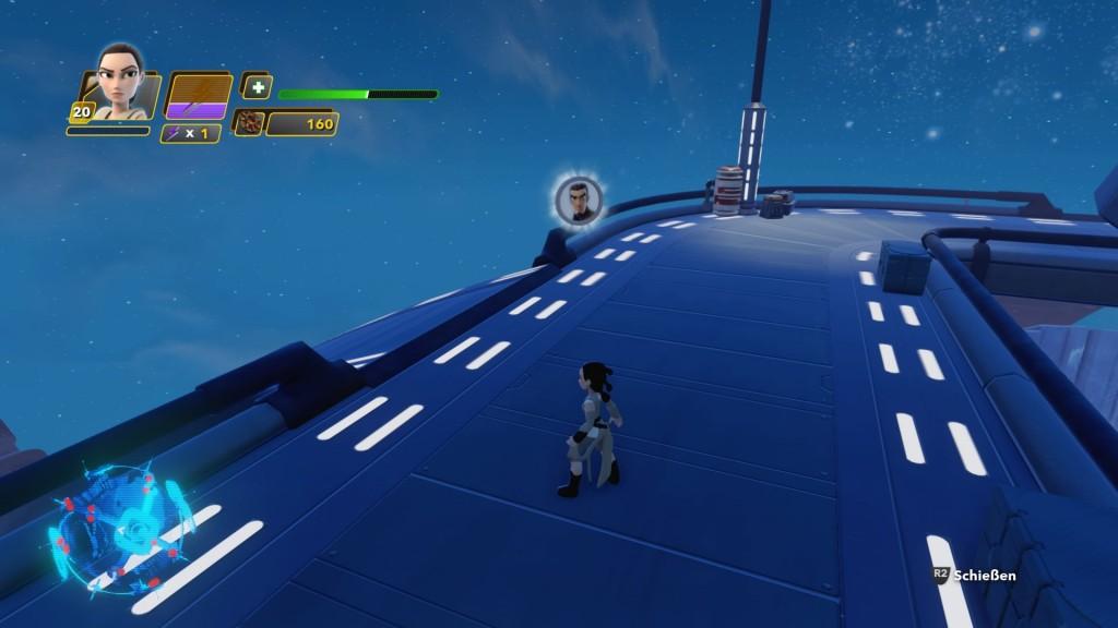 Auf dem gleichen Mond dreht ihr euch von den Landeplattformen aus nach rechts und folgt den aufgemalten Pfeilen auf dem Boden. Auf diese Weise erreicht ihr einen steilen Steg, der auf den ersten Blick nicht zu erkennen ist. Auf der Karte seht ihr den Weg allerdings eingezeichnet und könnt euch daran orientieren. Folgt dem Steg solange, bis ihr zu einem großen Gebäude gelangt. Links davon befindet sich die Münze von KANAN JARRUS aus Star Wars Rebels. Über die grünen Bodenschalter auf dem Steg gelang ihr direkt zurück zur Landeplattform.